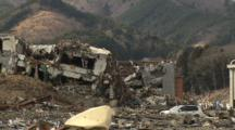 Japan Tsunami Aftermath - Helicopters Fly Over Ruins Of Onagawa City