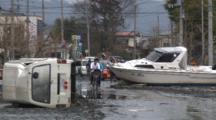 Japan Tsunami Aftermath - Vehicles And Boat Block Street In Ishinomaki City
