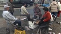 Japan Tsunami Aftermath - Survivors Sit Around Fire On Street In Ishinomaki City