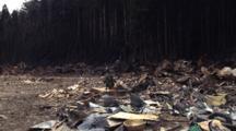 Japan Tsunami Aftermath - Soldier Walks Through Burnt Out Debris In Shizugawa City