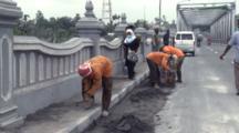 Workers Scrape Volcanic Ash From Bridge After Major Eruption Of Merapi