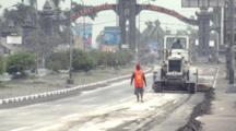 Workers Clear Highway Covered In Volcanic Ash After Major Eruption
