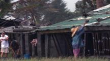 Farmer Secures Huts Before Hurricane Hits