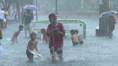 Street Kids Play In Flood Waters Manila Philippines