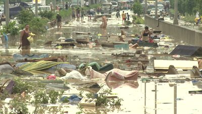 People Wade In Filthy Flood Waters In Manila Philippines