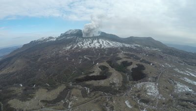 Aerial Footage Volcano Erupts Steam Nearby