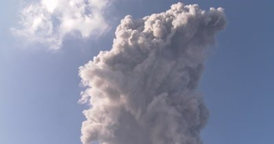 Large Volcanic Ash Cloud Rises Into Sky After Eruption At Volcano