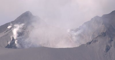 Steaming Crater Of Active Volcano Close Up