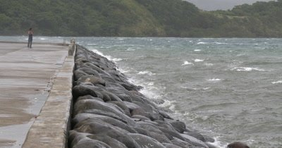 Waves Splash Against Sea Wall In Strong Winds