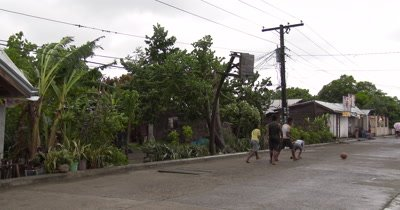 Kids Play Basketball On Street In Philippines