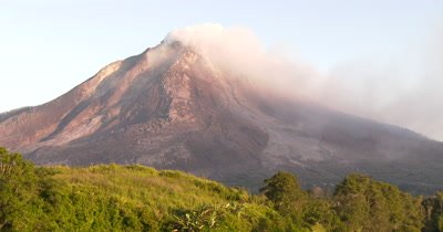 Unstable Dangerous Sinabung Volcano Steams Quietly In Morning Sun
