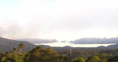 Pan To Sinabung Volcano Steaming Ominously