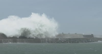 Huge Hurricane Waves Crash Over Harbor Sea Wall