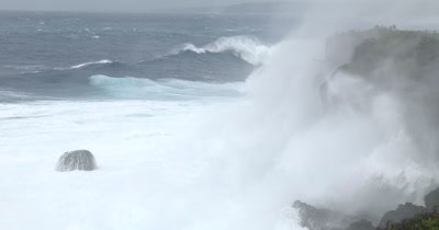 Large Hurricane Wave And Blowing Spray Lash Cliffs