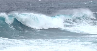 Tracking Shot Huge Hurricane Wave Crashing Into Cliffs