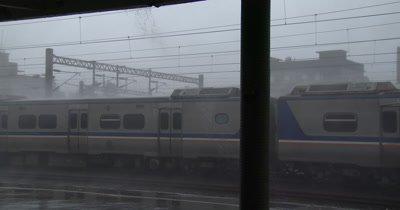 Violent Hurricane Wind Lashes Train Station