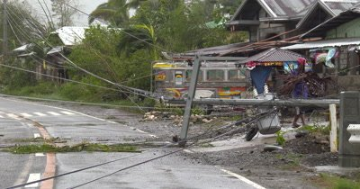 Downed Power Lines Block Road After Hurricane
