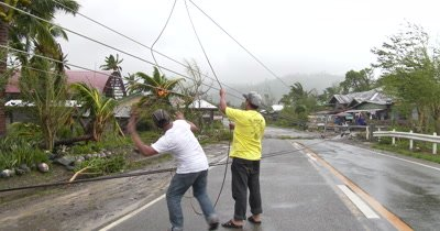 Power Lines Block Road After Hurricane Landfall