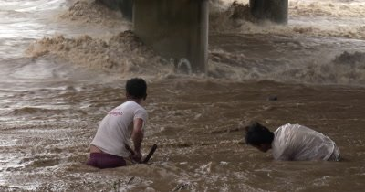 Fishermen Tackle Raging Flood Waters In River