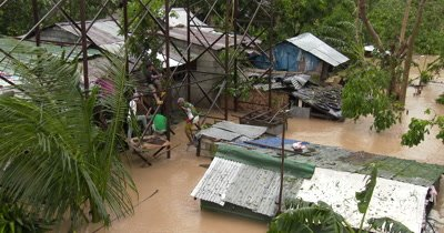 Flood Water Submerges Slum Houses During Hurricane