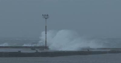 Hurricane Waves Crash Into Harbor Sea Wall