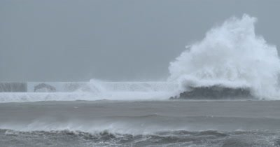 Large Storm Waves Crash Into Sea Wall In Hurricane