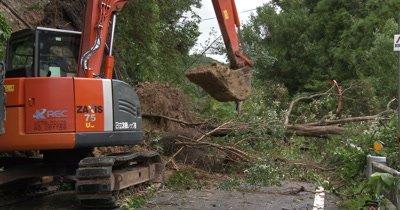 Clearing Landslide Debris From Blocked Road