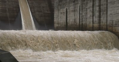 Flood Water Flows From Dam Hydroelectric Plant