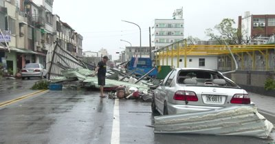 Large Debris Blocks Street In Front Of Damaged Car Major Hurricane Aftermath