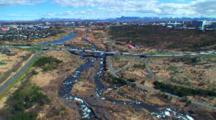 Aerial Over City Of Reykjavik, Rivers, Highway