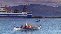Men Row Boat In Reykjavik Harbor