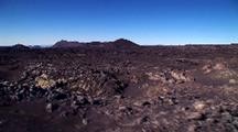 Aerial Over Desolate Volcanic Landscape