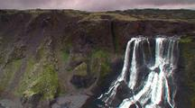 Icelandic Waterfall Cascades Down Cliff