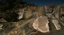 Water Flows Down Colorful, Steaming Rock At Hot Spring
