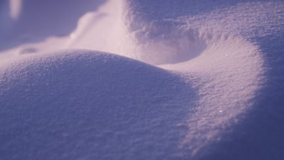Scenic - Detail shot of snow that has been shaped by wind.  Rich shadows cast by setting sun.  Tight.