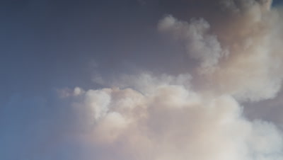 Scenic timelapse of smoke from a forest fire roiling up into a dark sky.  Med.