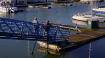 Fishermen Walking Down Dock At Harbor