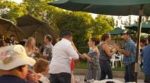 People Dancing At Outdoor Party