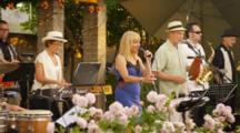 Musicians In Band Play For Outdoor Party