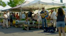 Young Street Performers, Fiddle, Guitar, Musicians Play At Farmers Market While People Shop
