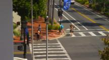 Looking Down On Santa Barbara Intersection With Traffic, Pedestrians, Bicycle