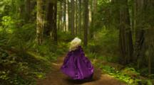 Nordic Woman In Renaissance Costume Running Through Redwood Forest