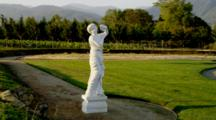 Chateau In Oregon, Marble Statue Of Woman With Grapes, Vineyard Behind
