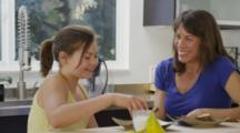 Family At Home, Mom-Dad-11yr & 6 Yr Daughters, Eating Lunch At Kitchen Counter