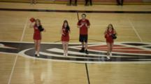 Cheerleaders Cheer On Basketball Court, One Girl Tumbles