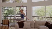 Young Thin Tall Pretty Blonde Girl With Pony Tail, Dances In Living Room