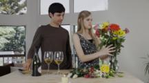 Young Couple In Kitchen With Flowers, Wine