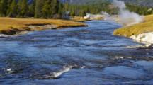 Blue Yellowstone River, Geyser Steaming On Bank, Fall