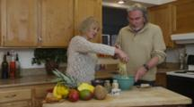 Private Home, Retired Couple Preparing Preparing Pasta, Seasoning, Grating Cheese, Cooking Together