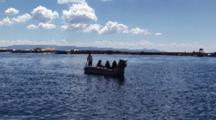 People Travel On Traditional Reed Boat On Lake Titicaca